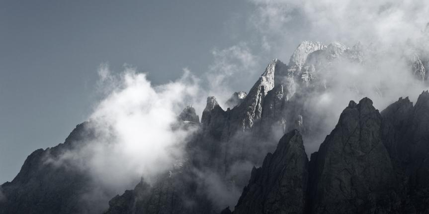 Impressive high mountain view – mountain peaks in mist